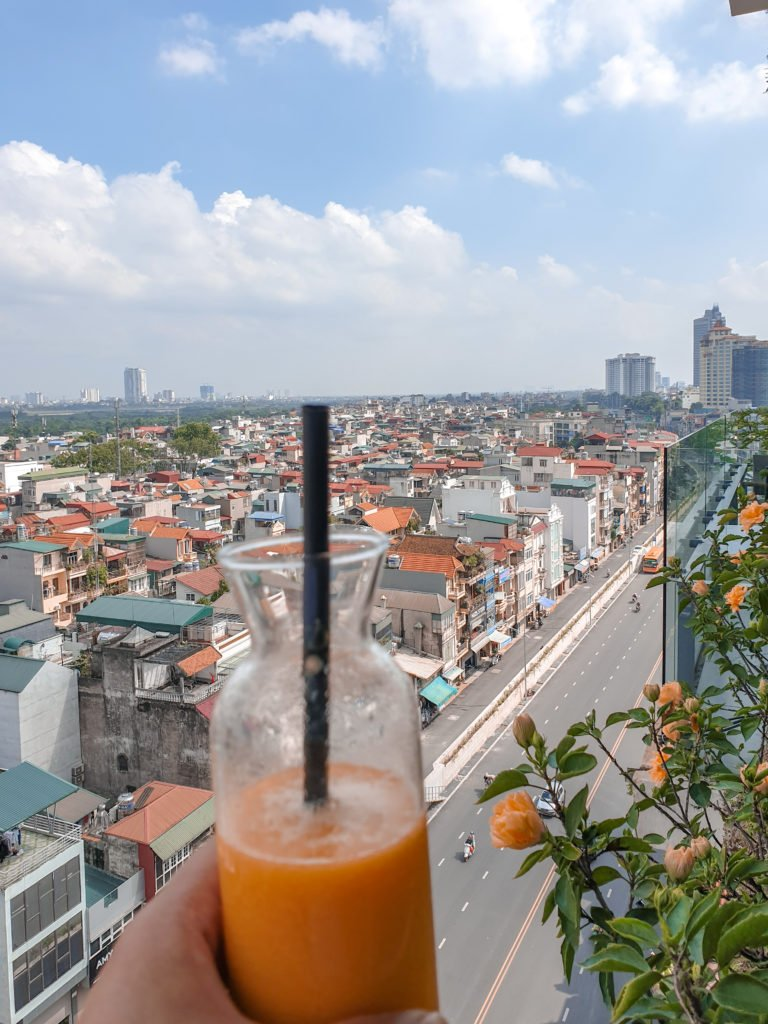 Orange juice overlooking hanoi city